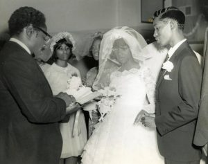 African American couple performing wedding vows in Toledo, Ohio - 1960s